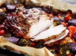 Juicy roast pork on the plate with vegetables