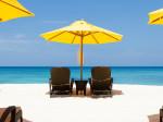 Yellow sun umbrellas and chairs on beach