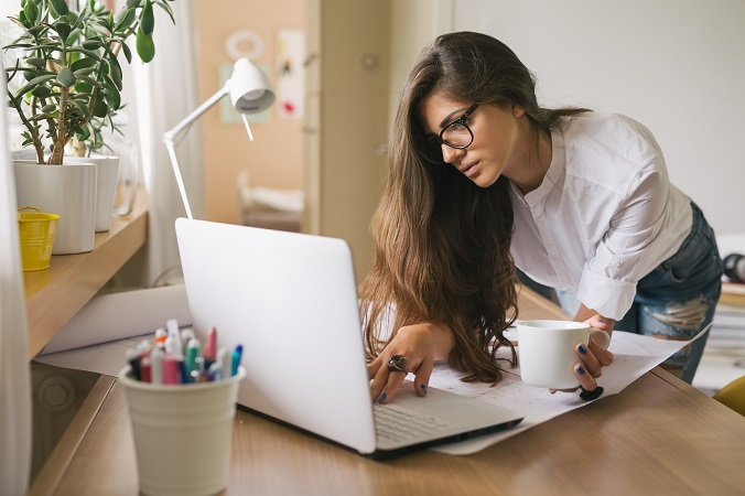 Running her business from home.young woman working on a computer in her home office