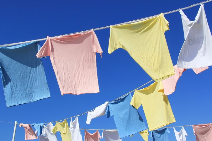 T-shirts hanging on rope in front of blue sky