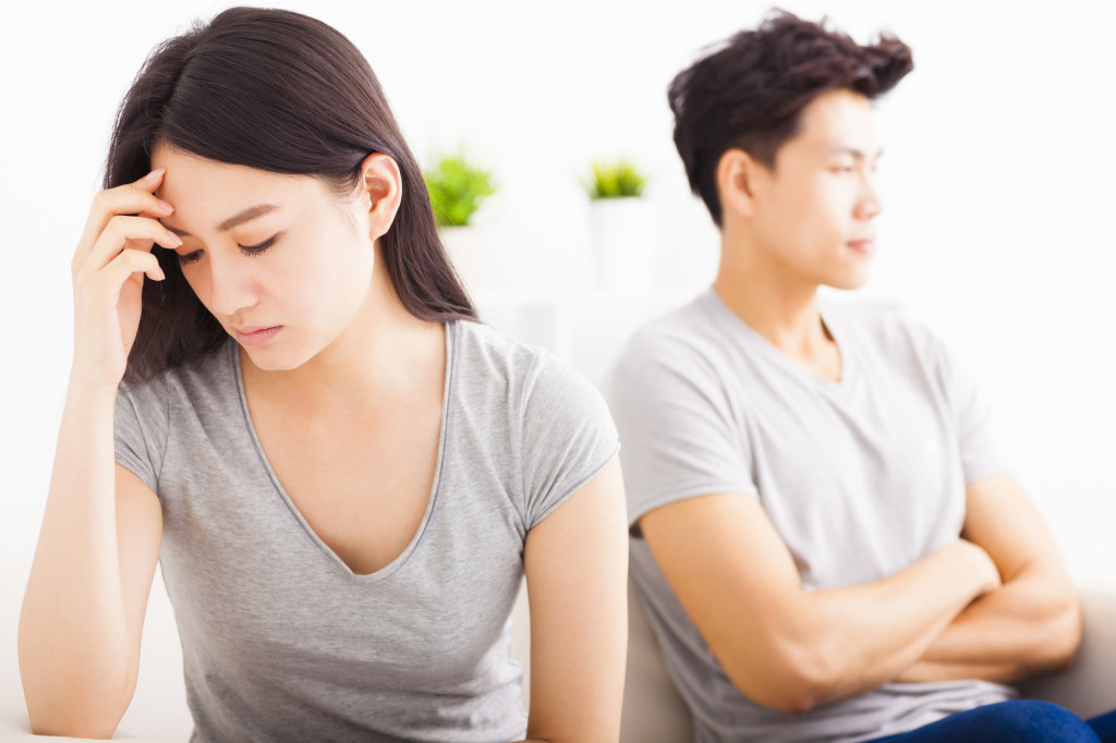 young Couple not talking after  fight  in living room