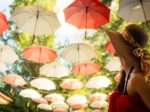 Female tourist marvels at baldachin of umbrellas