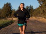 happy girl walking on a rural dirt road