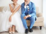 Groom and bride sitting on couch, closeup