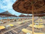 Umbrellas and chairs on the beach, in Nea Flogita - Halkidiki Gr