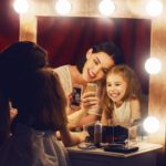 Mother and daughter are doing makeup