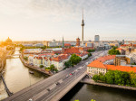 Berlin skyline with TV tower and Spree river at sunset, Germany