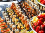 meat, fish, vegetable canaps on a festive wedding table outdoor