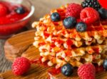 Belgian waffles with fresh berries and coffee