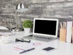 Creative office desktop with blank laptop