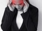 woman with headache, migraine, stress, insomnia, hangover  with red danger alert accent