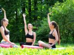 Laughing woman doing a group fitness workout together outdoor.