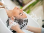 Hairdresser washing hair