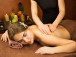 Attractive lying young woman in spa salon