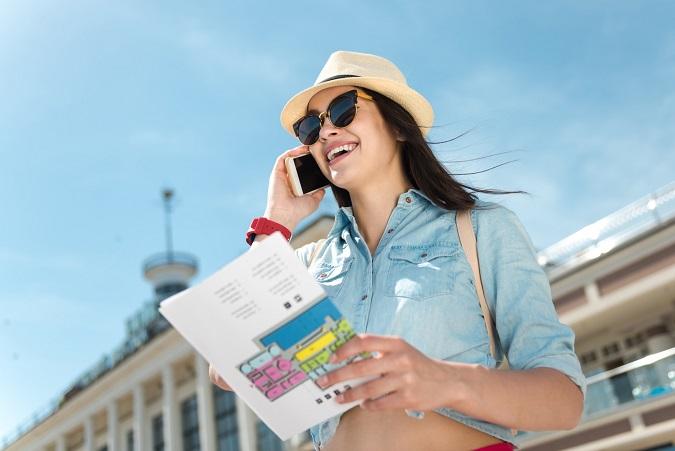Beautiful joyful woman talking on cell phone