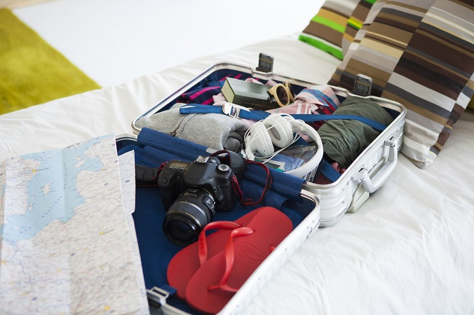 Suitcase which is spread on the bed