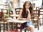 Stylish  woman, wearingsummer dresst,  posing at city cafe terra