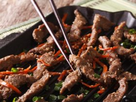 Bulgogi beef with carrot and onion on the grill macro. horizontal